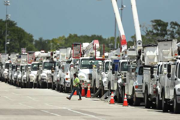 Utility trucks being staged at Daytone International Speedway in Florida on Saturday, August 1, 2020, in preparation for Tropical Storm Isaias. The storm only swiped the Florida coast, but was expected to gain strength ahead of a landfall Monday night in the Carolinas before continuing up the coast. (Stephen M. Dowell/Orlando Sentinel/TNS)