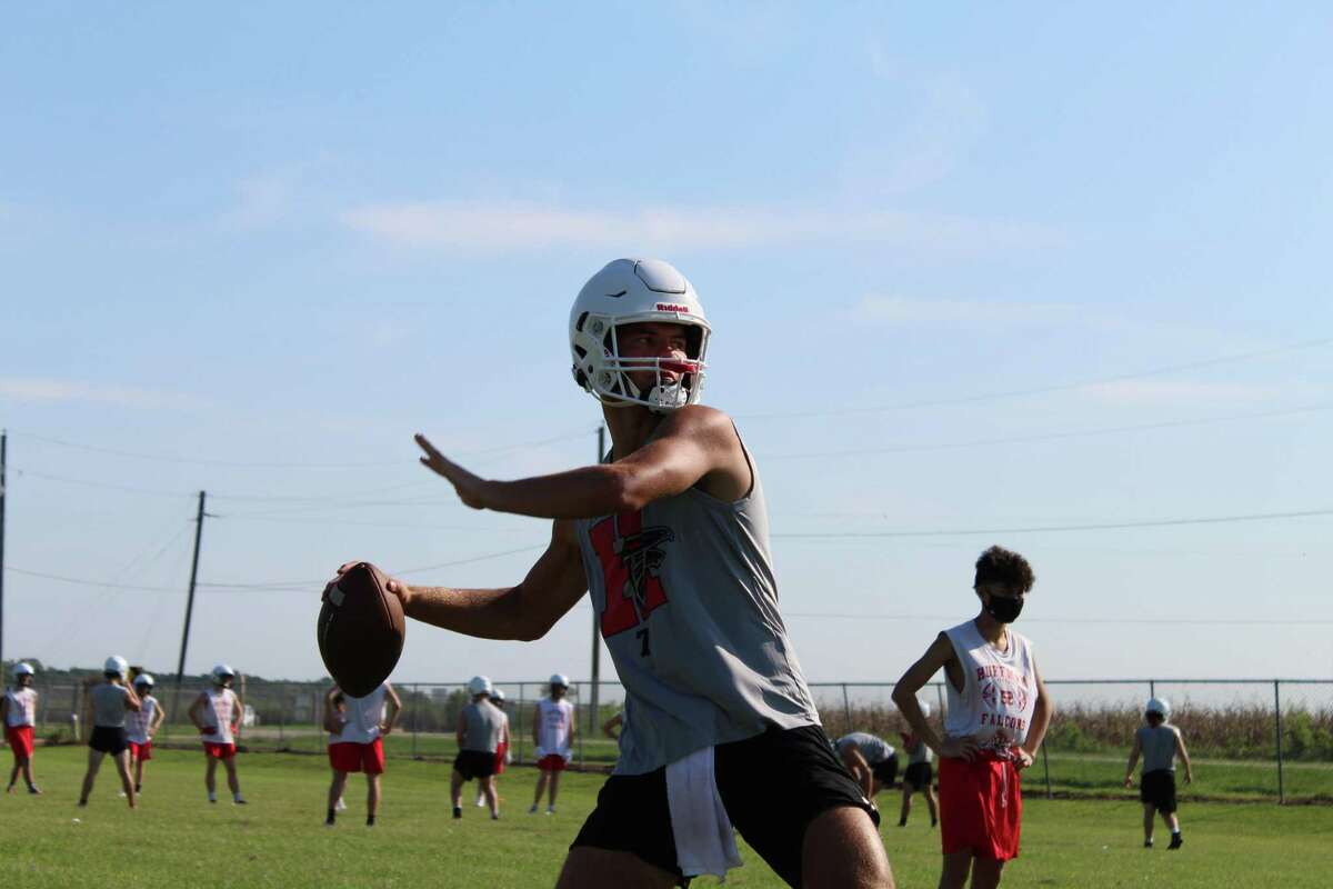 Hargrave quarterback Luke Thomas throws to wide recievers in a drill on the first day of fall camp/