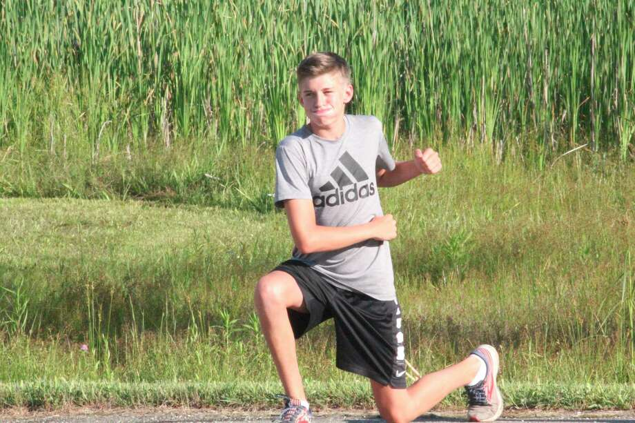 Reed City's Ty Kailing works to get into shape prior to a summer cross country run. (Pioneer photo/John Raffel)