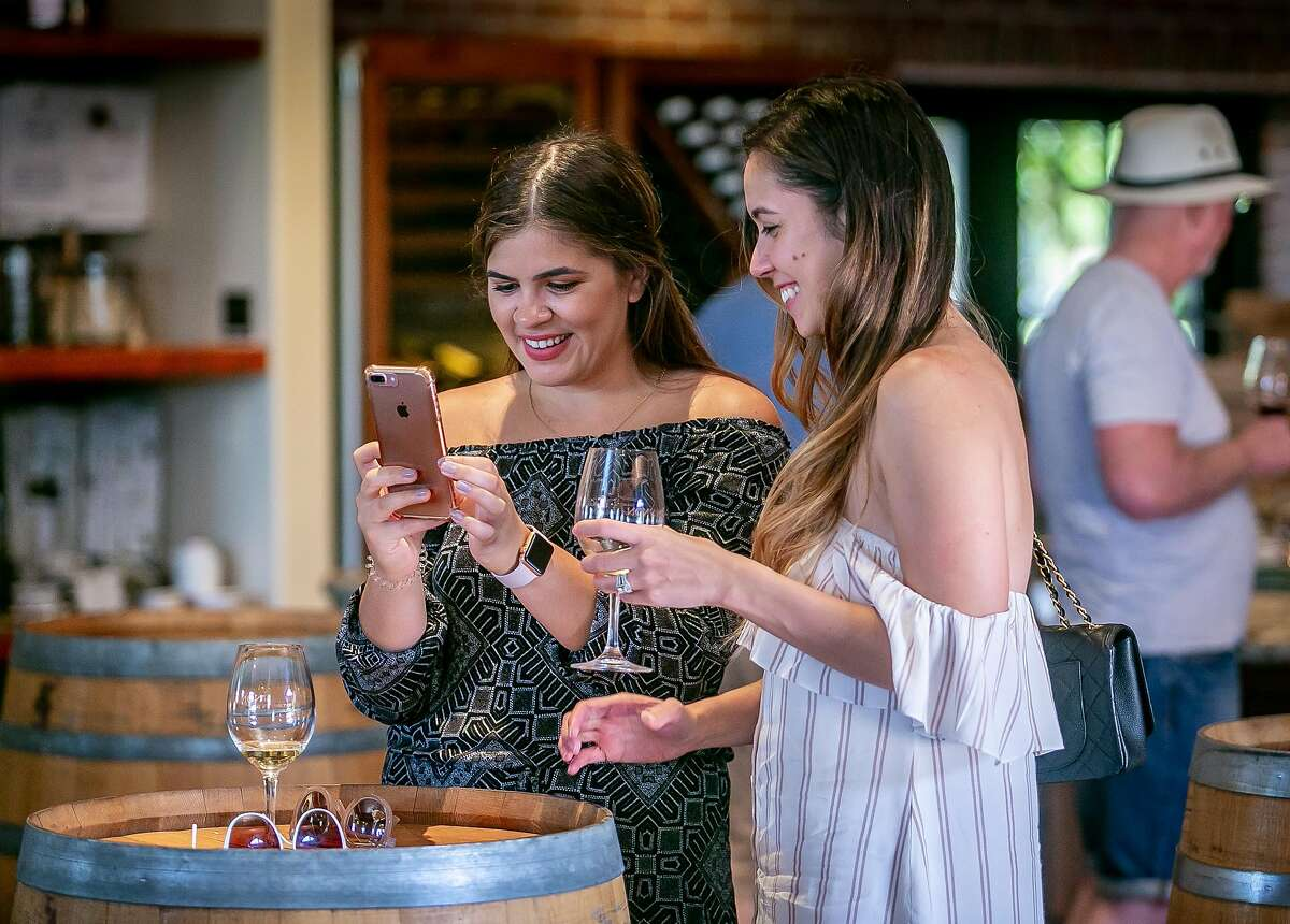 People taste wine at the Concannon tasting room in Livermore, Calif. on August 17th, 2018.