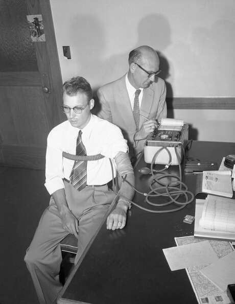 Shortly after the discovery of Stephanie Bryan's belongings in his home, Burton Abbott voluntarily submitted to a polygraph. The results were inconclusive. At right, conducting the test is A. E. Riedel, the Bay Area's leading polygraph expert at the time. Photo: Bettmann/Bettmann Archive
