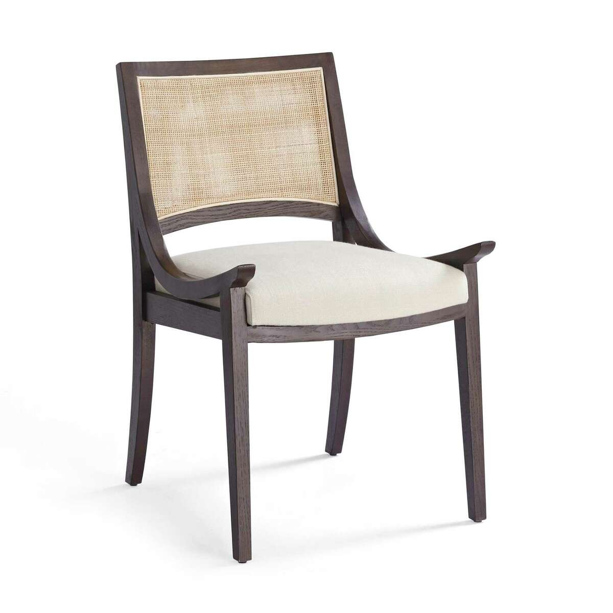 The newest design from Frontgate is the Whitman dining chair, an oak frame with low-swept arms, double-caned back and a seat of ivory linen performance fabric or forest green leather. $499-$599; frontgate.com