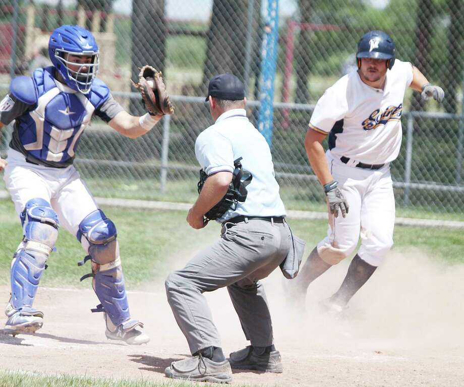 The Manistee Saints' Lucas Richardson, right, is called safe for a walk-off win at Rietz Park this summer. (News Advocate file photo)