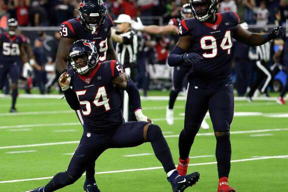 Jacob Martin and Charles Omenihu celebrate a sack against the Bills in last season's playoffs. The development of those two players this year will be a big factor in the pass rush, along with a healthy J.J. Watt.