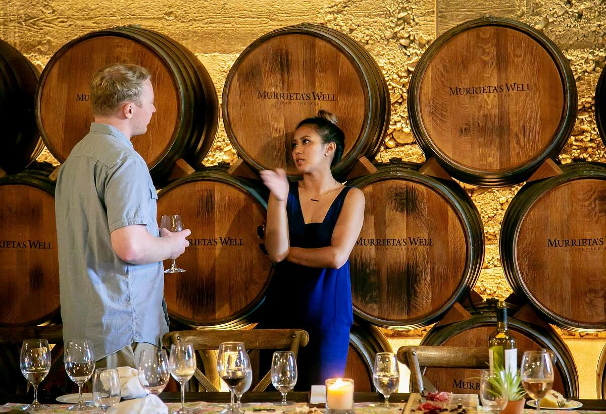 People taste wine at Murrieta's Well Winery in Livermore, Calif. on August 25th, 2018.