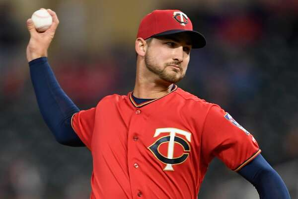Chase De Jong #61 of the Minnesota Twins delivers a pitch against the Chicago White Sox during the first inning in game two of a doubleheader on September 28, 2018 at Target Field in Minneapolis, Minnesota. (Photo by Hannah Foslien/Getty Images)