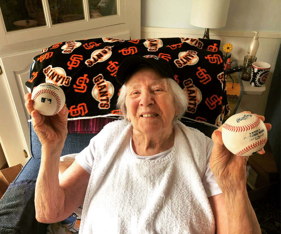 Dave Edlund's mother, 92-year-old Margaret Edlund, holds the two Yastrzemski home run balls he caught in McCovey Cove. Photo: Courtesy Of Dave Edlund