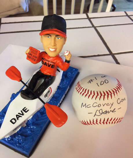 A bobblehead of Dave Edlund and a ball he caught in McCovey Cove. Photo: Courtesy Of Dave Edlund