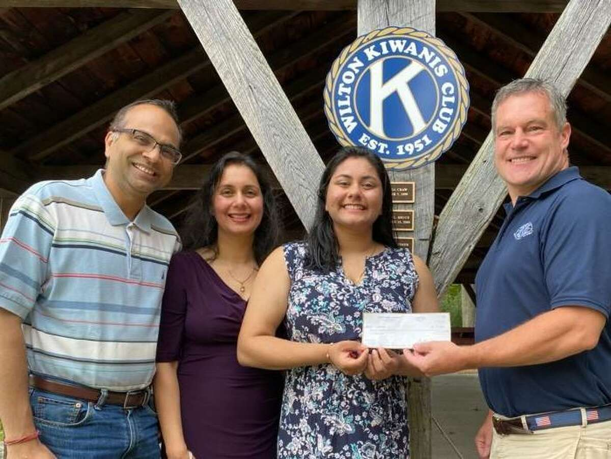 Megha Gupta, along with her parents, Deepender Gupta and Rakhee Agarwa, receives a scholarship from Jeff Turner, Wilton Kiwanis Club liaison to the Key Club. Megha, who graduated in June from Wilton High School, was honored for her work in Key Club as well as local organizations including the Wilton Volunteer Ambulance Corps and Wilton Community Emergency Response Team.