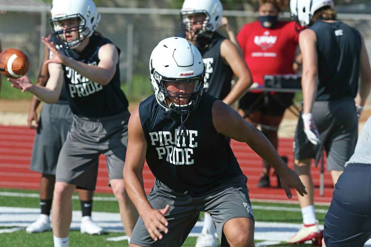 Trevor Fuller runs drills during the Poth High School football team's first practice of the season, Monday, Aug. 3, 2020.