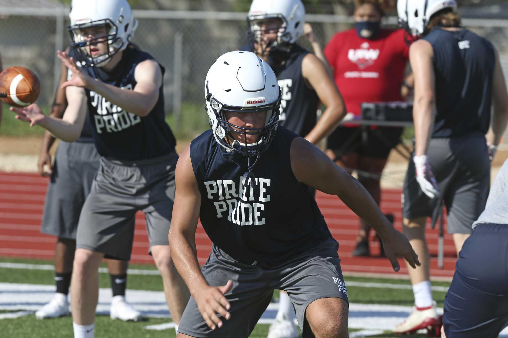 Trevor Fuller runs drills during Poth High School football team's first practice of the season, Monday, Aug. 3, 2020. Monday is the first day football teams in UIL class 4A and 1A can practice in Texas.