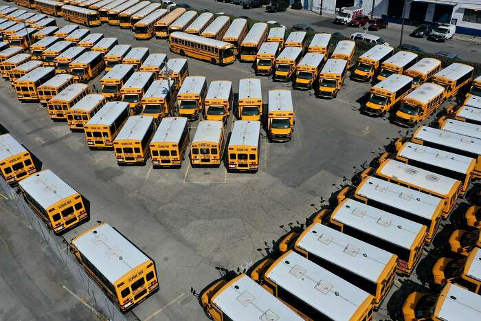 SAN FRANCISCO, CALIFORNIA - JULY 14: School buses sit parked in a lot at First Student Charter Bus Rental on July 14, 2020 in San Francisco, California. Los Angeles and San Diego public schools announced they will only offer a remote-only return to school August as coronavirus COVID-19 cases continue to rise in Southern California. (Photo by Justin Sullivan/Getty Images) *** BESTPIX ***