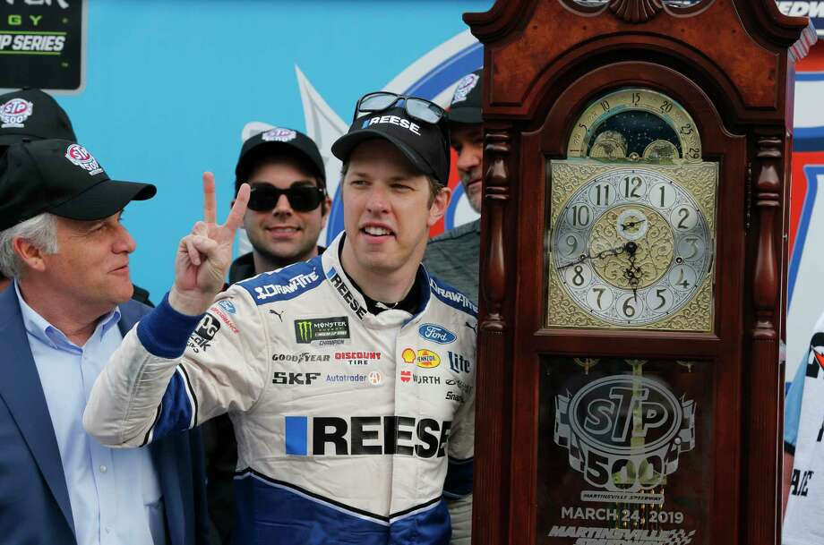 Brad Keselowski (2) celebrates with the trophy grandfather clock in Victory Lane after winning a NASCAR Cup Series auto race at Martinsville Speedway in Martinsville, Va., Sunday, March 24, 2019. (AP Photo/Steve Helber) Photo: Steve Helber / Copyright 2019 The Associated Press. All rights reserved