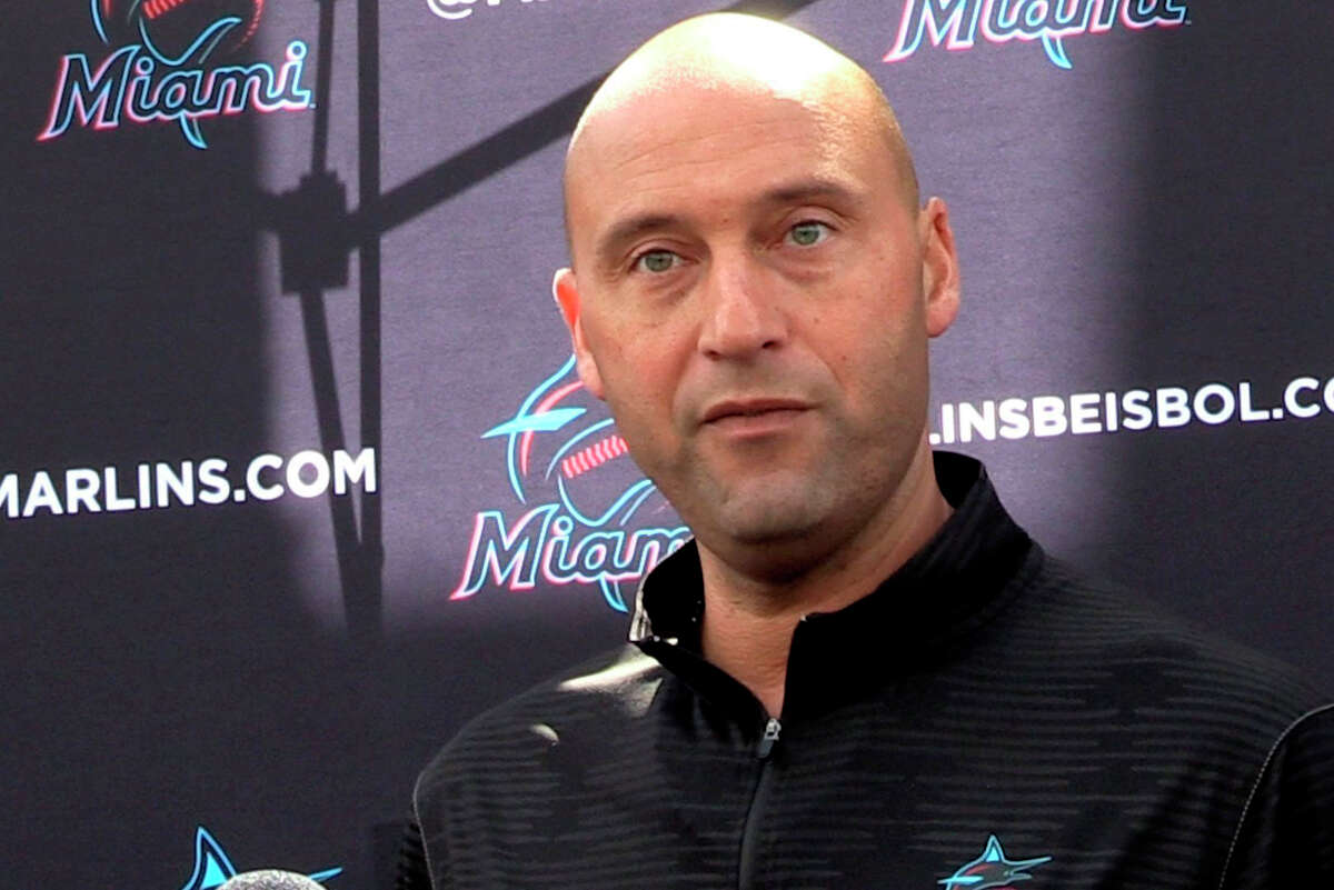 FILE - In this Feb. 24, 2020, file photo, Miami Marlins CEO Derek Jeter talks to the media before the team plays the St. Louis Cardinals in a baseball game in Jupiter, Fla. Jeter blames the teama€™s coronavirus outbreak on a collective false sense of security that made players lax about social distancing and wearing masks. Infected were 21 members of the teama€™s traveling party, including at least 18 players. (Charles Trainor Jr./Miami Herald via AP, File)