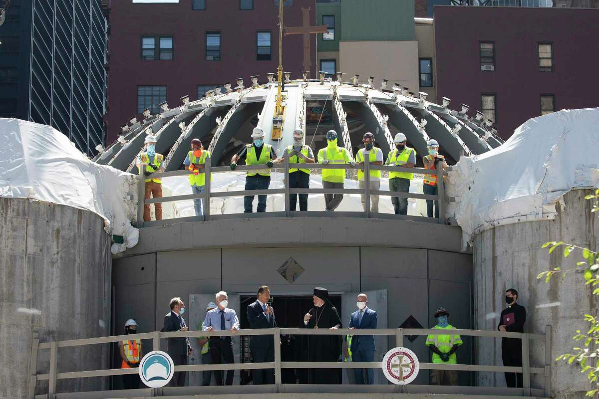 A group of clergy, politicians and construction workers attends a ceremony at the St. Nicholas Greek Orthodox Church, Monday, Aug. 3, 2020 at the World Trade Center in New York. The original church was destroyed in the attacks of Sept. 11, 2001. The shrine is expected to open in 2021. (AP Photo/Mark Lennihan)