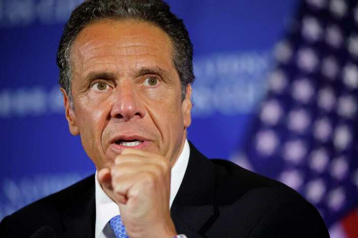 In this May 27, 2020, file photo, New York Gov. Andrew Cuomo speaks during a news conference at the National Press Club in Washington. Cuomo says he opposes raising taxes on the wealthy to help the state whether the coronavirus economic crisis, but it is clear that federal aid alone wona€™t solve the statea€™s fiscal woes. (AP Photo/Jacquelyn Martin, File)