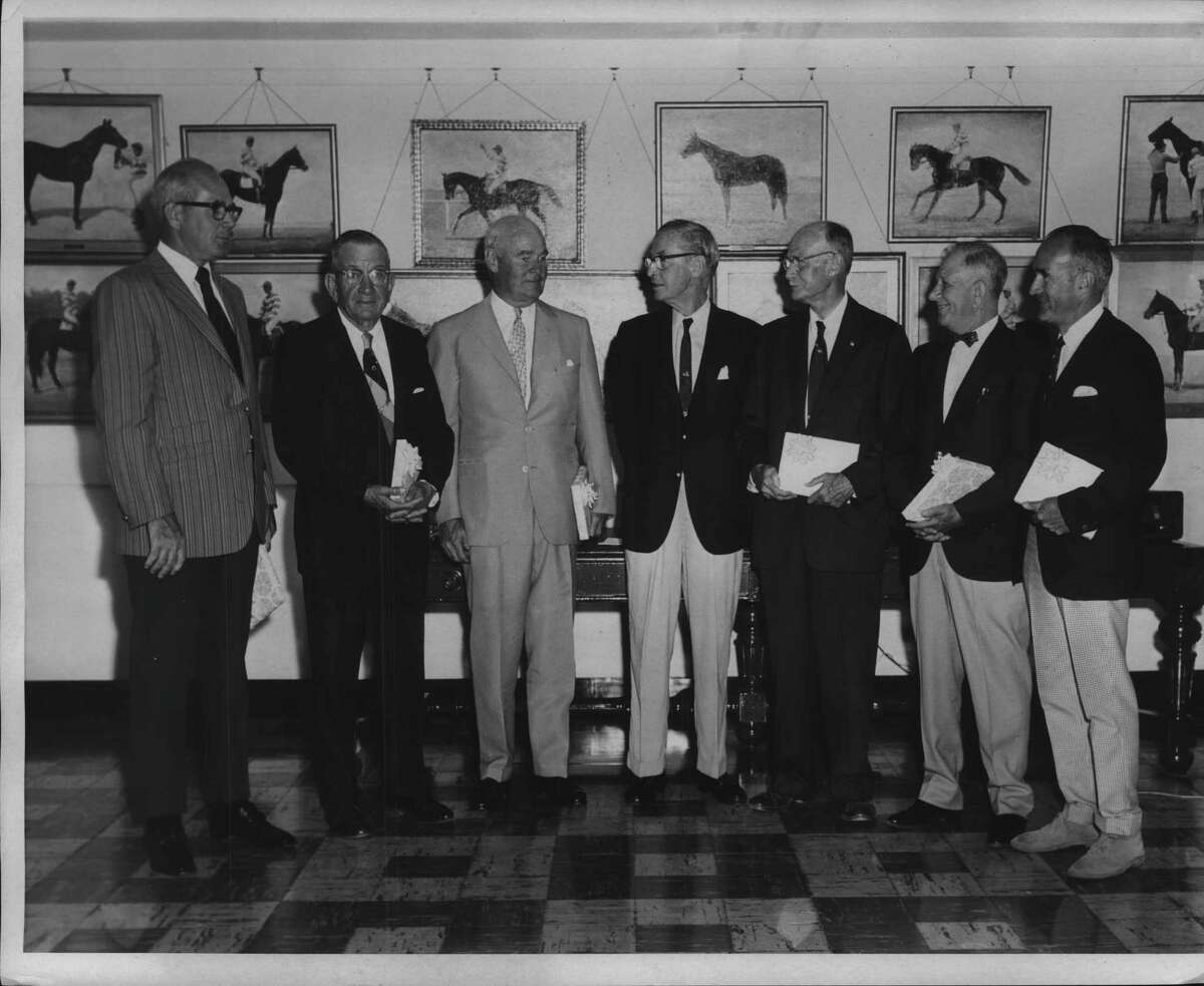 Induction ceremony at National Museum of Racing in Saratoga Springs in August 1970 includes museum officials and trainer, breeder, owner and jockeys for the horse Buckpasser. (Bob Coglianese/Times Union Archive)