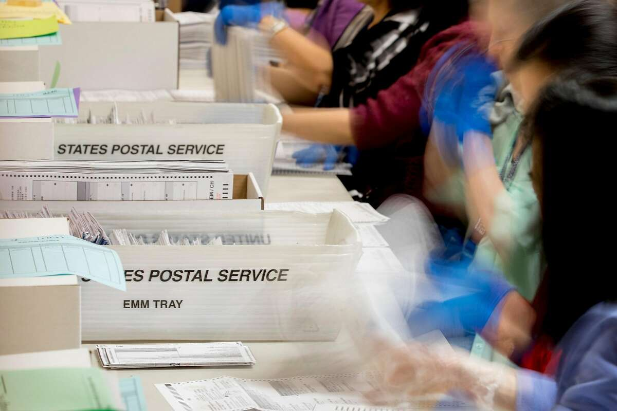 Election staff work to sort through vote-by-mail ballots ahead of the March 3rd election at San Francisco City Hall in San Francisco, Calif. Friday, February 28, 2020.
