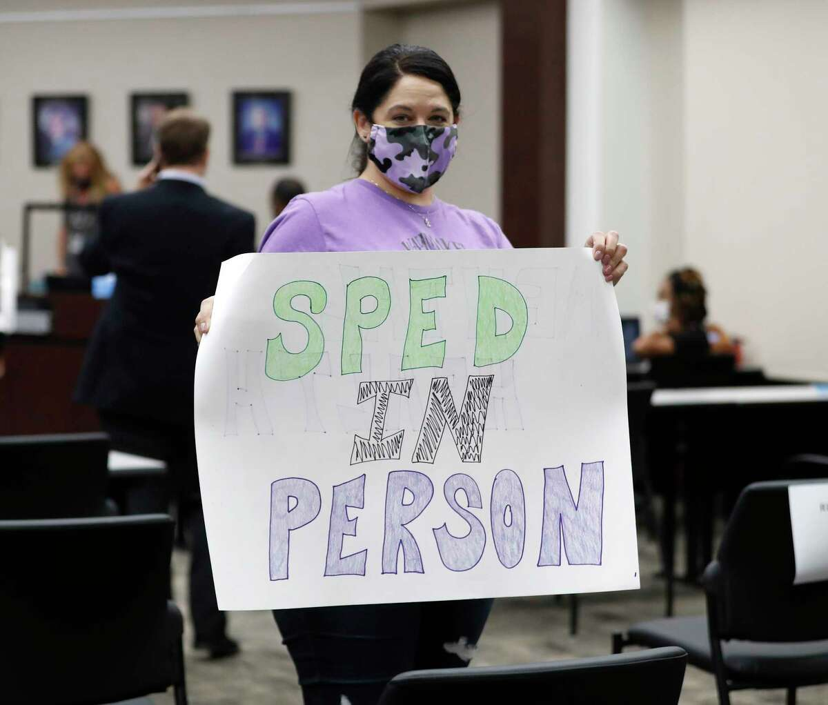 """Francesca Pepiton holds a sign that says """"SPED in person"""" as she was advocating for her best friend whose autistic son is only able to learn in person, and she has children in the Humble school district during the Humble ISD board meeting to discuss the reopening of schools, Monday, August 3, 2020, in Humble."""