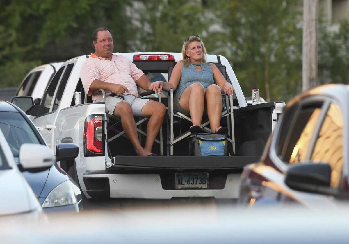 Riverside's Tom and Patti Waurishuk listen to music by the Jukebox 45 '50s and '60s cover band in a socially distant concert at the Horseneck Lane parking lot in Greenwich, Conn. Wednesday, July 29, 2020. The performance was part of Greenwich Parks and Recreation's Summer
