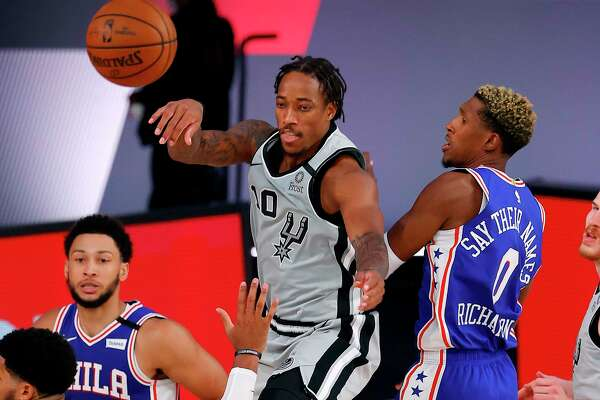 DeMar DeRozan (10), who scored a game-high 30 points, helped the Spurs rally from a 14-point, second-half deficit, but it wasn't enough to overcome the Philadelphia 76ers on Monday in Orlando, Fla.