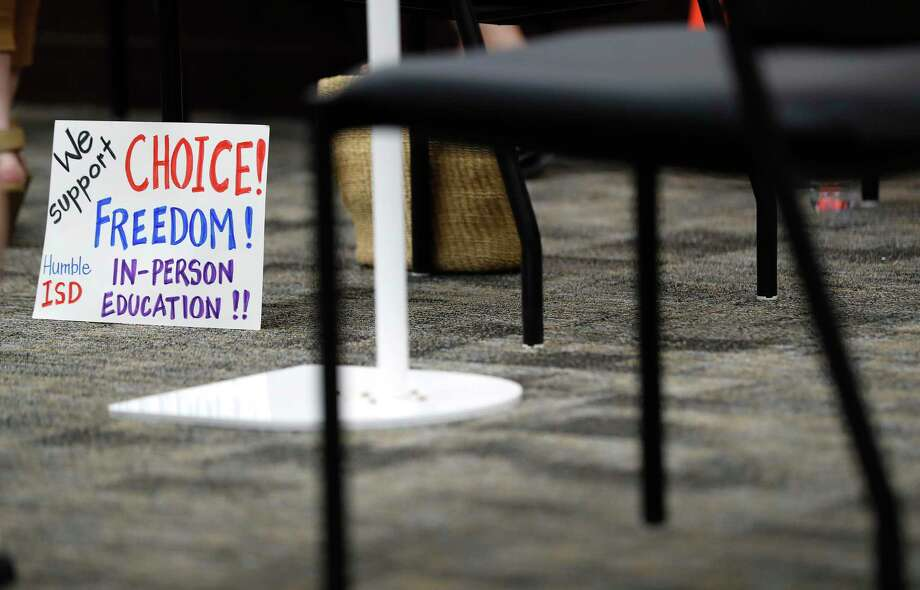 A sign advocating for in-person education during a bathroom break before more discussion during the Humble ISD board meeting to discuss the reopening of schools, Monday, August 3, 2020, in Humble. Photo: Karen Warren, Houston Chronicle / Staff Photographer / © 2020 Houston Chronicle