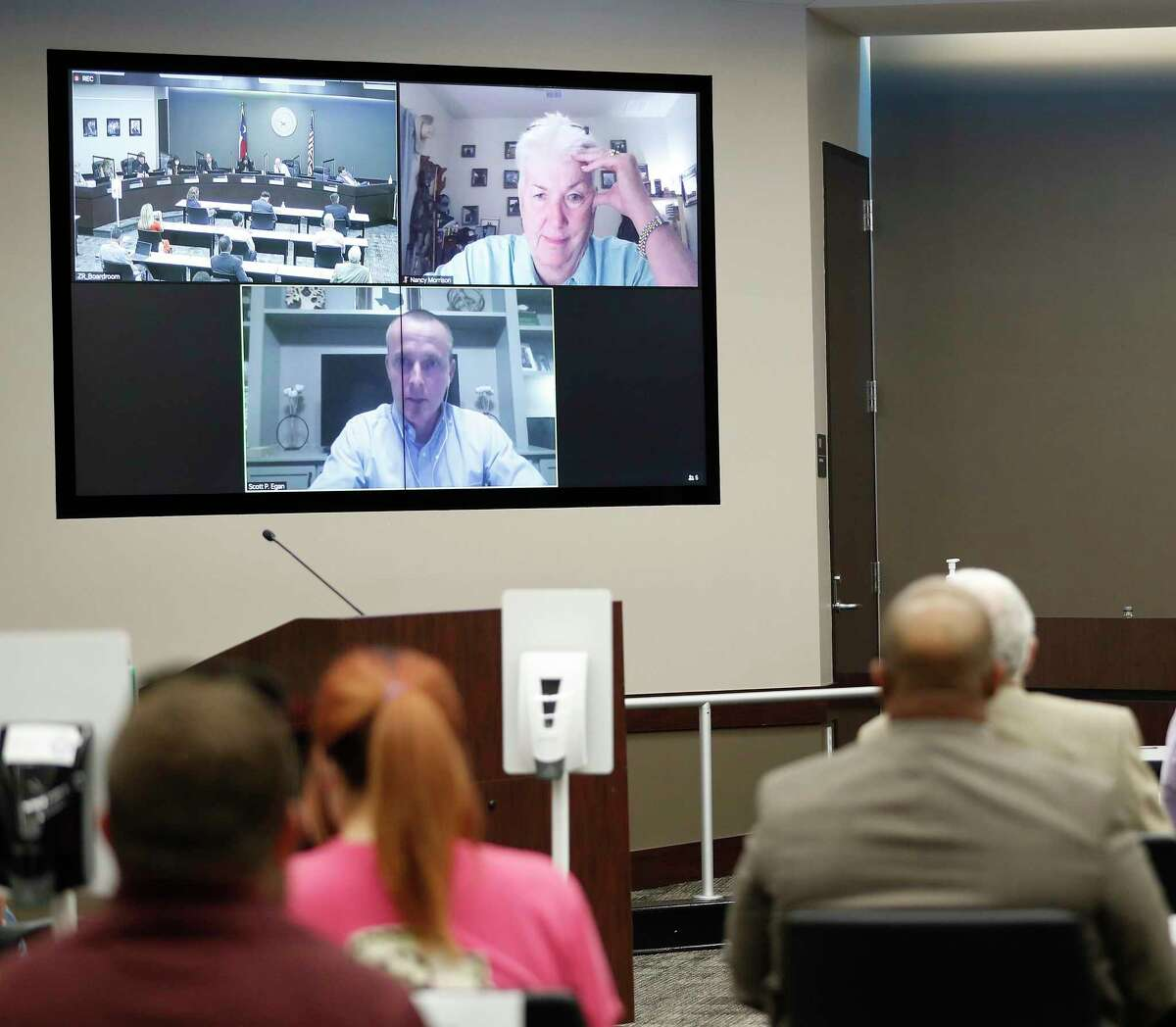 Scott Egan speaks to board members, including Nancy Morrison via zoom during the Humble ISD board meeting to discuss the reopening of schools, Monday, August 3, 2020, in Humble.