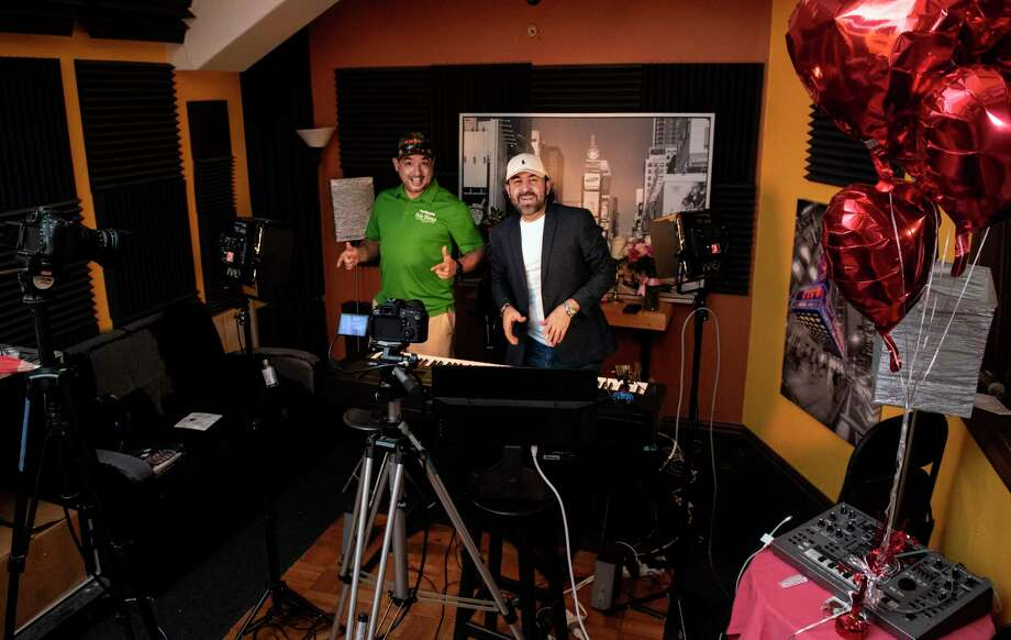 Ramon Fidalgo and Musician Vicente Peña pause for a photo with the equipment in their studio, Friday. Photo: Danny Zaragoza /Laredo Morning Times