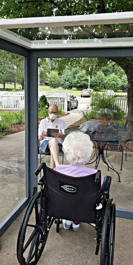 Weather permitting, families can schedule 30-minute outdoor visits with residents at University Care Center. Photo: For The Intelligencer