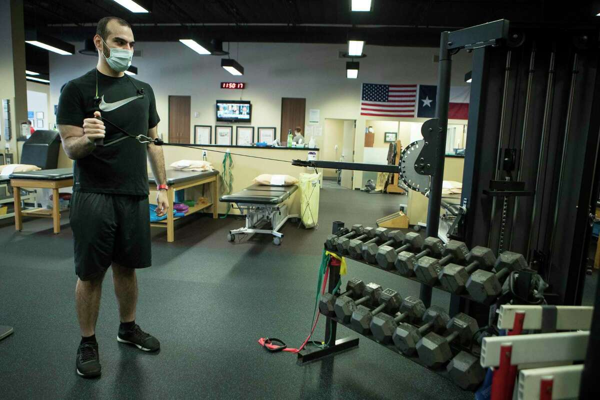Amer Ismail works out as he continues physical therapy on Thursday, July 30, 2020 at Memorial Hermann Ironman Sports Medicine and Rehabilitation in Houston. Ismail was had lost close to 200 pounds in 2019. A year later, he has run his first marathon, tore his ACL, gone to rehab, got skin removal surgery, gone to rehab again.