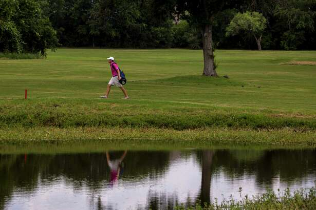 A golfer walks the Republic Golf Club course. The club closed this spring.