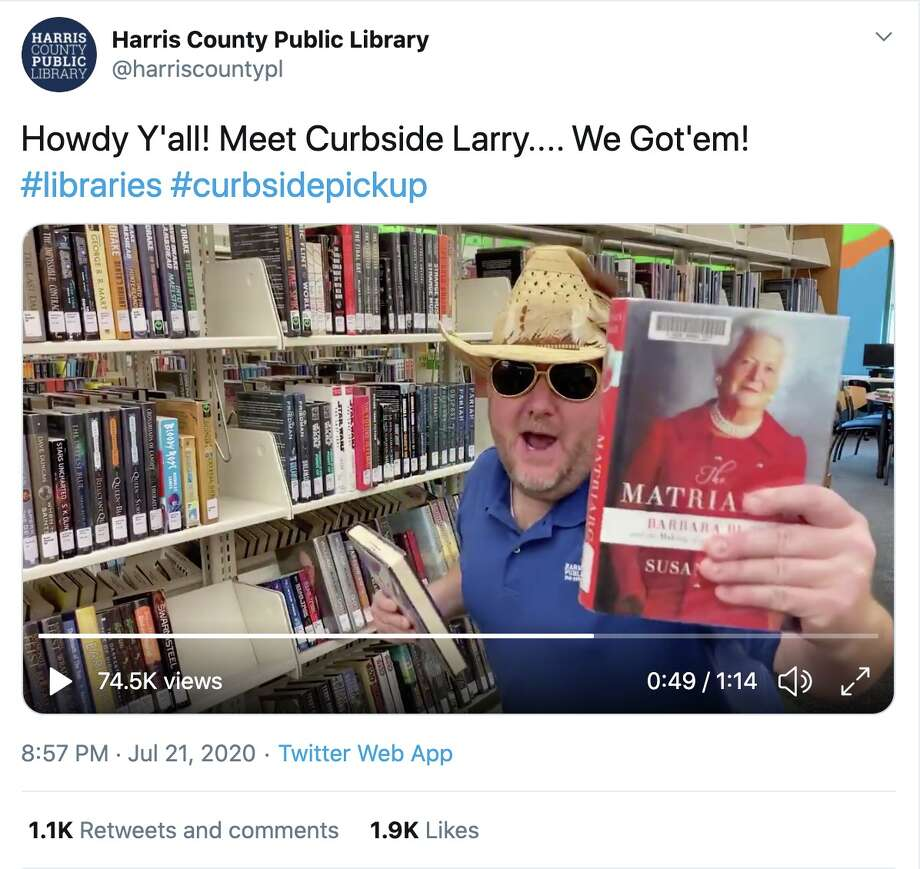 "Curbside Larry holds up ""The Matriarch,"" a biography on the late First Lady and Houstonian Barbara Bush who championed literacy issues. Photo: Twitter / @harriscountypl"