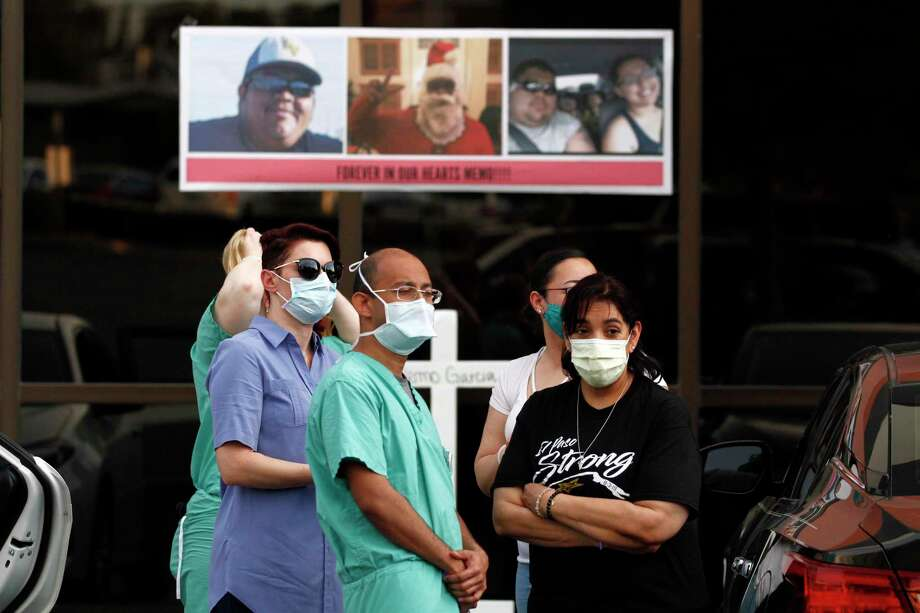 "In May mourners in masks honor Walmart shooting victim Guillermo ""Memo"" Garcia, in El Paso. As if racism and violence against Latinos isn't deadly enough, in some places, they're three or four times more likely to get COVID-19 and die. Photo: Cedar Attanasio /Associated Press / Copyright 2020 The Associated Press. All rights reserved"