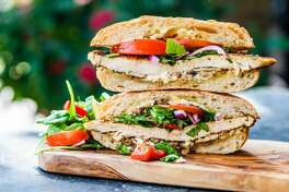 KRBE's Roula Christie has debuted 'Roula's Greek Getaway' sandwich at Antone's for charity.