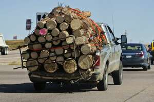 Pickup truck overloaded with cargo.