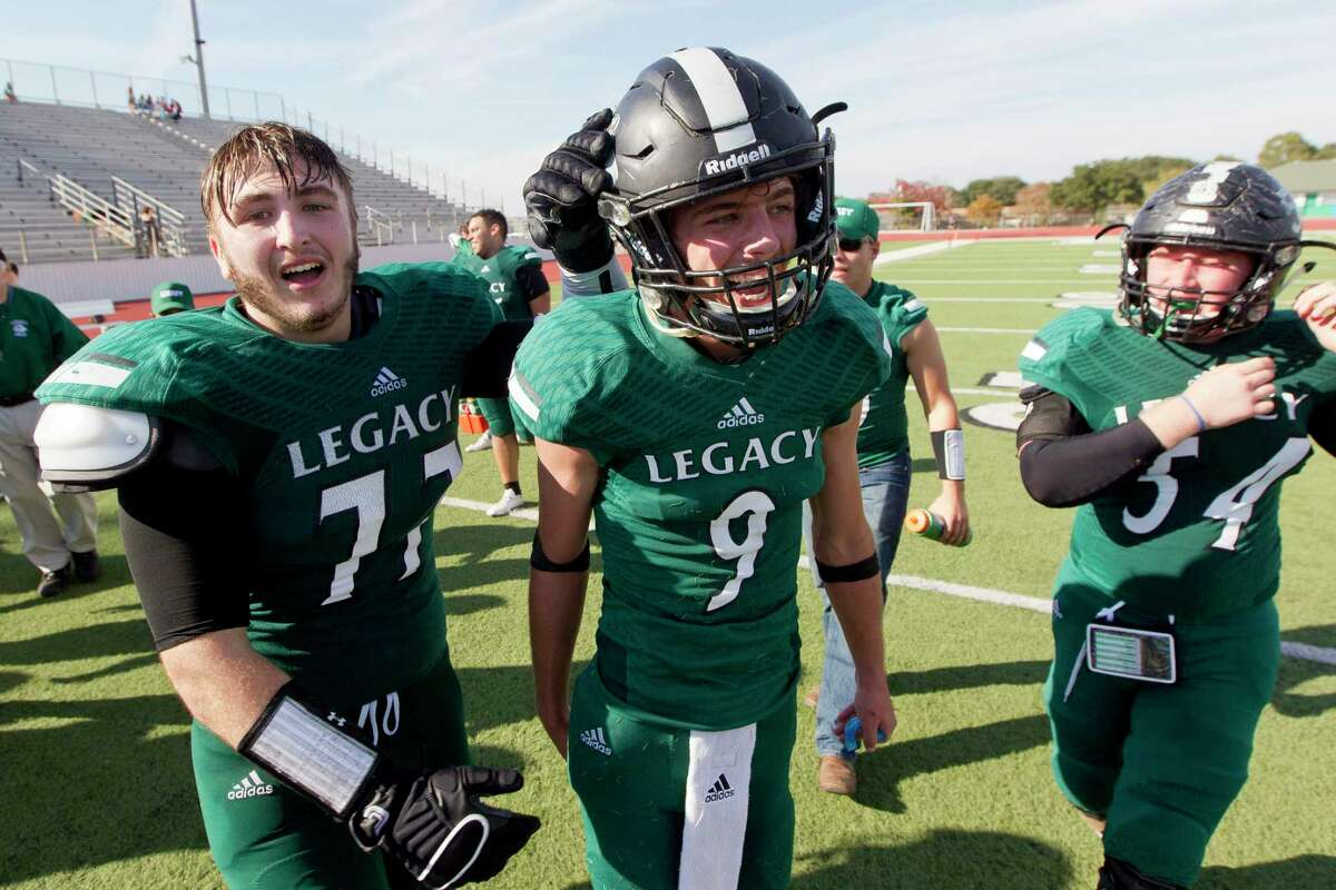 Legacy Prep offensive linemen Cater Jones, left, celebrates with quarterback Jared May, center, after defeating Brazos Christian 21-14 during a TAPPS Division IV state semifinal game at Cub Stadium, Saturday, Dec. 2, 2017, in Brenham.