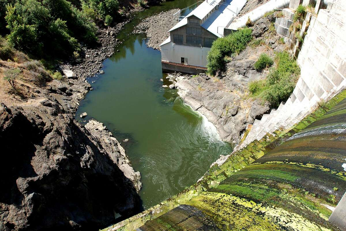 Water trickles over Copco 1 Dam on the Klamath River outside Hornbrook (Siskiyou County). Northwest lawmakers introduced a bill in Congress in 2011, authorizing two landmark agreements to remove this dam and three others owned by PacifiCorp on the river to help salmon, and to assure farmers of irrigation.