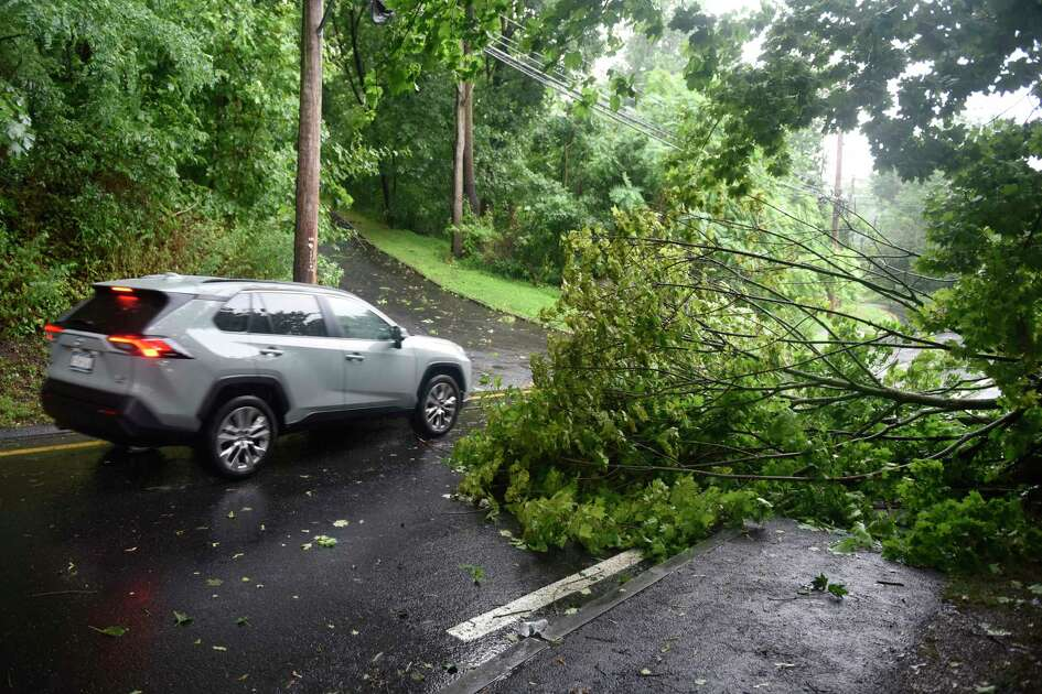A tree is down on Glenville Road as tropical storm Isaias brings heavy wind and rain to Greenwich, Conn. Tuesday, Aug. 4, 2020. The National Weather Service issued a tropical storm warning, flash flood watch, and tornado watch as the storm passed through Connecticut.