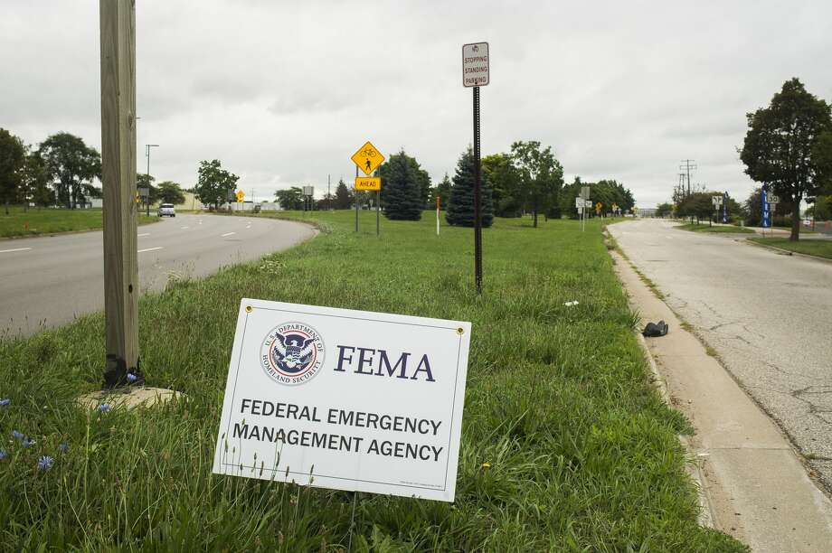 Officials with FEMA staff a documentation drop-off center Tuesday, Aug. 4, 2020 at Dow Diamond for those impacted by the May flooding to submit any required supporting documents for their disaster assistance applications. (Katy Kildee/kkildee@mdn.net) Photo: (Katy Kildee/kkildee@mdn.net)