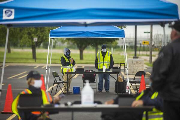 Officials with FEMA staff a documentation drop-off center Tuesday, Aug. 4, 2020 at Dow Diamond for those impacted by the May flooding to submit any required supporting documents for their disaster assistance applications. (Katy Kildee/kkildee@mdn.net)
