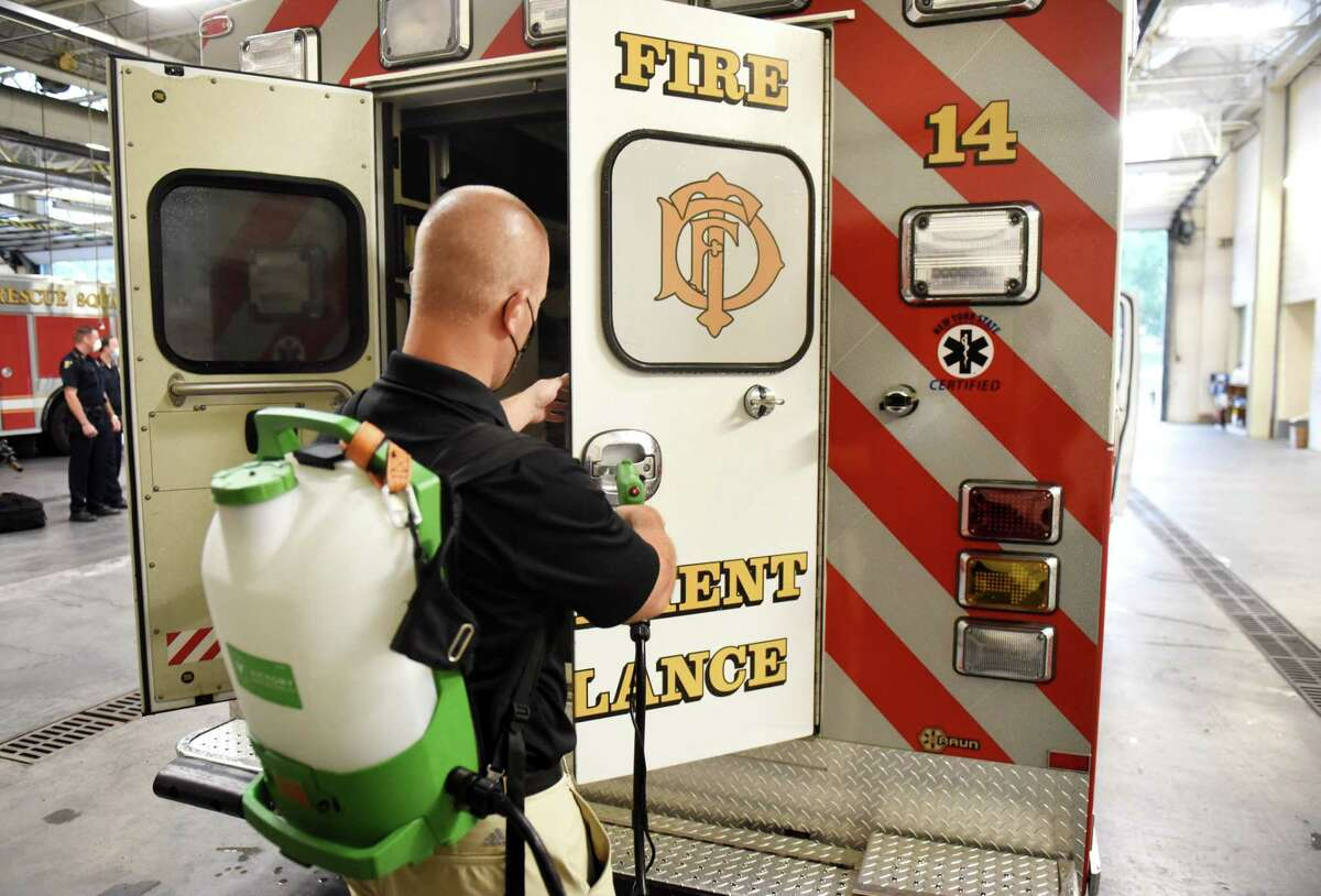 Vincent Laurenzo, CEO, Quick Response, uses a sanitizing sprayer to disinfect a Troy Fire Department ambulance on Tuesday, Aug. 4, 2020, during a presentation at Troy Central Fire House in Troy, N.Y. MVP Health Care, CDPHP and Quick Response donated two sanitizing sprayers to the Troy police and fire departments to aide in the fight against COVID-19. (Will Waldron/Times Union)