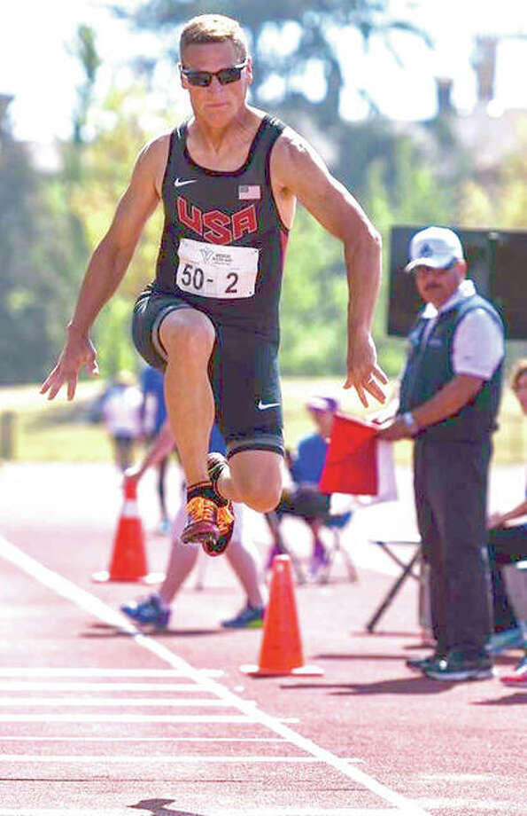 Mike Young, of Wood River, competing in a long jump during the U.S. Senior Games in Birmingham, Alabama. He is a Senior Olympian and state record holder. Photo: Submitted Photos|For The Telegraph
