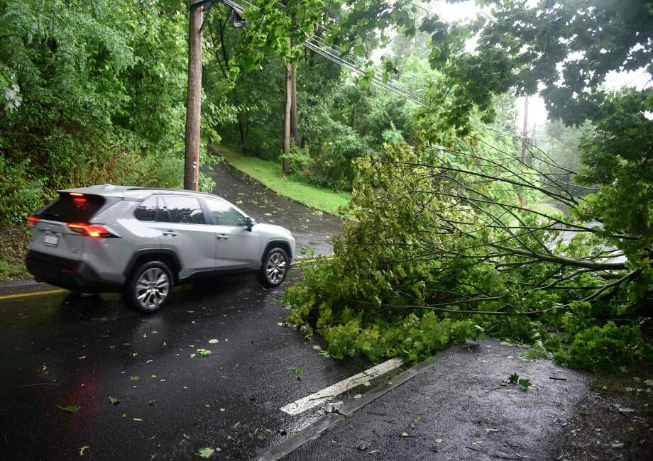 A tree is down on Glenville Road as tropical storm Isaias brings heavy wind and rain to Greenwich, Conn. Tuesday, Aug. 4, 2020. The National Weather Service issued a tropical storm warning, flash flood watch, and tornado watch as the storm passed through Connecticut. Photo: Tyler Sizemore / Hearst Connecticut Media / Greenwich Time