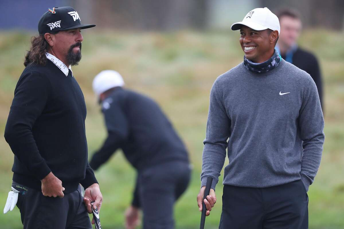 SAN FRANCISCO, CALIFORNIA - AUGUST 04: Tiger Woods of the United States talks with Pat Perez of the United States during a practice round prior to the 2020 PGA Championship at TPC Harding Park on August 04, 2020 in San Francisco, California. (Photo by Tom Pennington/Getty Images)