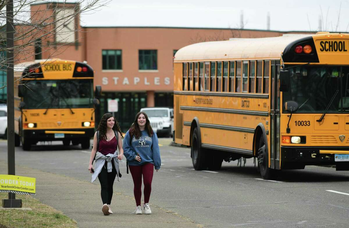 Students leave Staples High School on the announcement that Westport Schools will be closed for the unforeseeable future on March 11, 2020, in response to the COVID-19 virus pandemic.