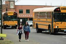 Students leave Staples High School on the announcement that Westport Schools will be closed for the unforeseeable future Wednesday, March 11, 2020, in response to the Covid-19 virus pandemic in Westport, Conn.