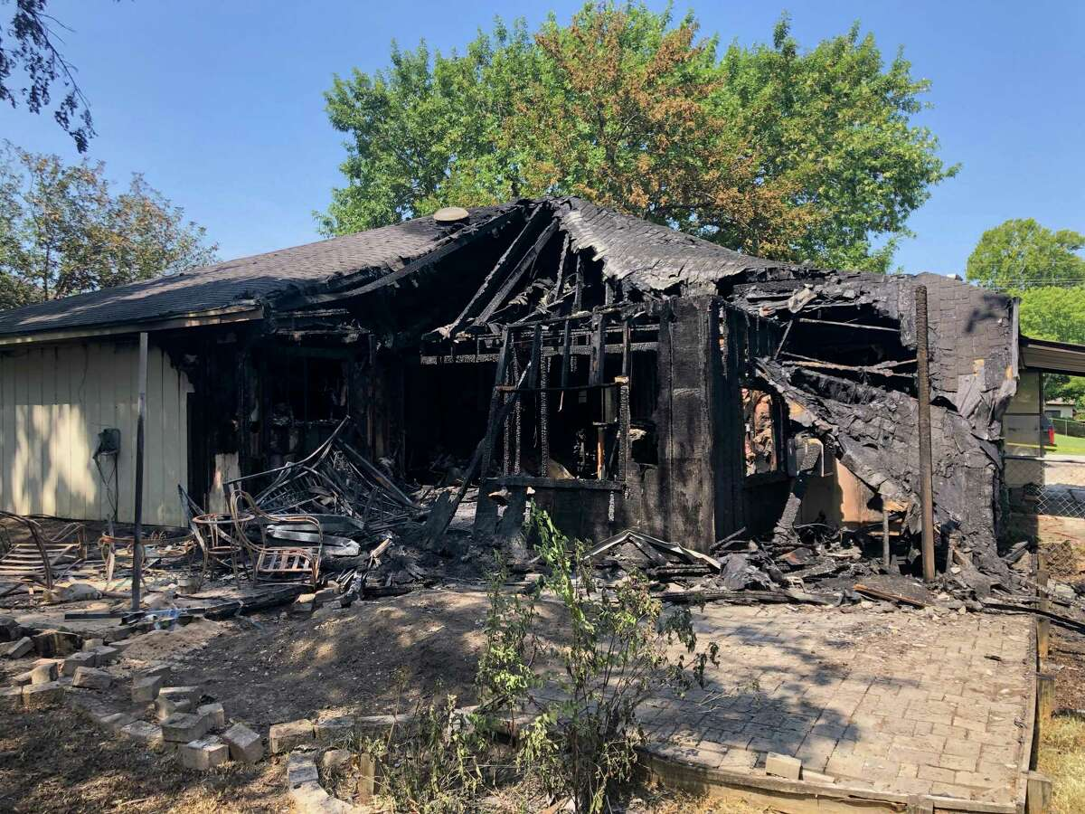 A Willis home engulfed by flames early Tuesday morning is seen hours after firefighters took out the blaze and rescued a teenager now in the hospital.