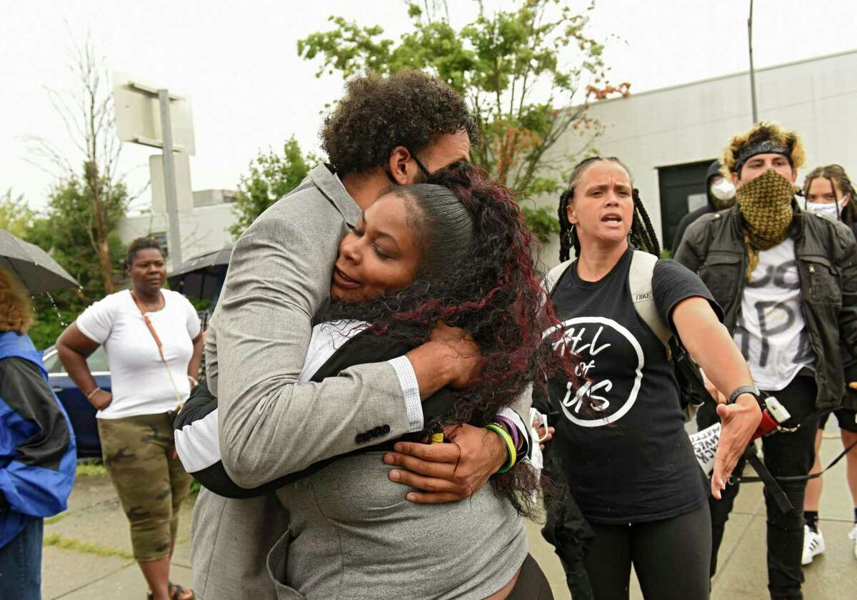 A supporter gives Jadyn Coutte, left, a hug as protesters in support of Justice for Jadyn are seen outside Albany City Court on Tuesday, Aug. 4, 2020 in Albany, N.Y. Jadyn appeared for his arraignment and was released on his own recognizance. Jadyn was arrested on July 10, 2020 following actions he says he took to defend his mother from aggressors. (Lori Van Buren/Times Union)