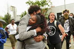 A supporter gives Jadyn Coutee, left, a hug as protesters in support of Justice for Jadyn are seen outside Albany City Court on Tuesday, Aug. 4, 2020 in Albany, N.Y. Jadyn appeared for his arraignment and was released on his own recognizance. Jadyn was arrested on July 10, 2020 following actions he says he took to defend his mother from aggressors. (Lori Van Buren/Times Union)