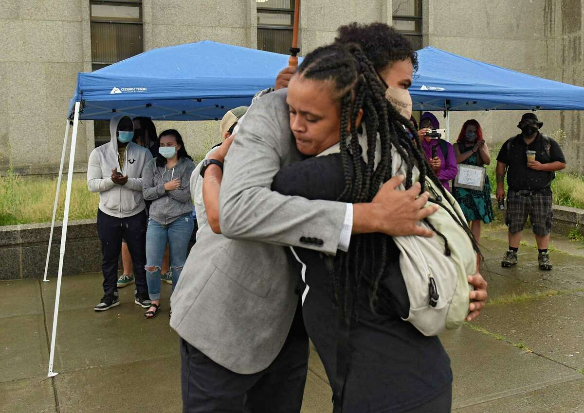 All of Us Co-Founder Jamaica Miles, right, gives Jadyn Coutte a hug as protesters in support of Justice for Jadyn are seen outside Albany City Court on Tuesday, Aug. 4, 2020 in Albany, N.Y. Jadyn appeared for his arraignment and was released on his own recognizance. Jadyn was arrested on July 10, 2020 following actions he says he took to defend his mother from aggressors. (Lori Van Buren/Times Union)